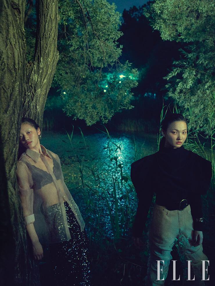 (왼쪽) 희원이 착용한 시스루 셔츠는 가격 미정, Leha. 이너 웨어로 착용한 브라렛은 가격 미정, Emporio Armani Underwear. 스팽글 펜슬 스커트는 가격 미정, Isabel Marant. 실버 이어링은 6만8천원, S by S.il. (오른쪽) 주향이 착용한 파워 숄더 톱은 1백8만원, Isabel Marant. 주름 장식이 독특한 팬츠는 가격 미정, Blindness. 버클 장식의 벨트는 30만원대, Polo Ralph Lauren. 커프는 가격 미정, Monica Vinader.