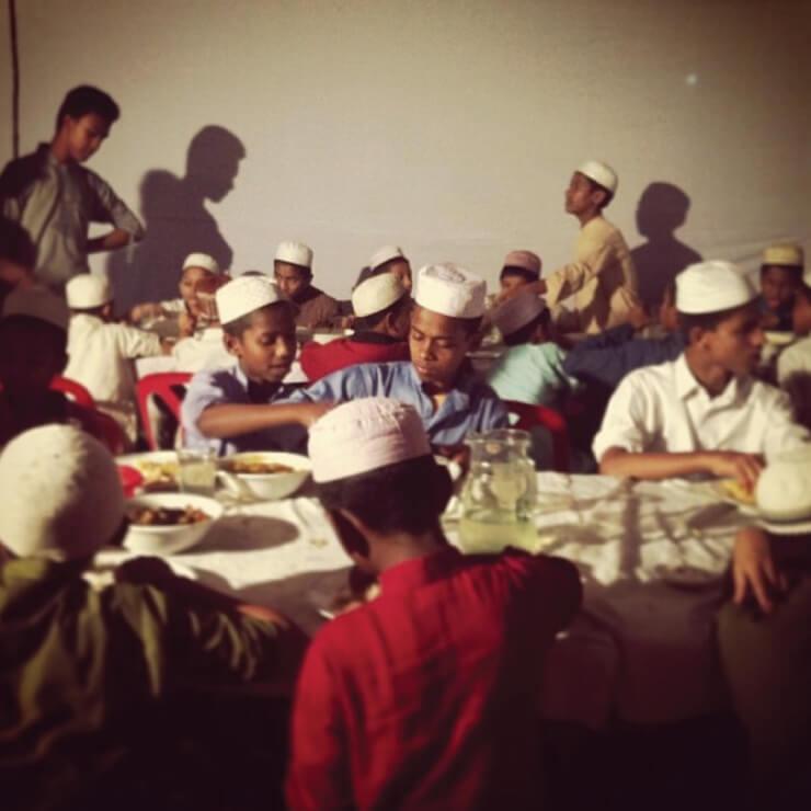 'Orphans at traditional chittagonian mezban'.
