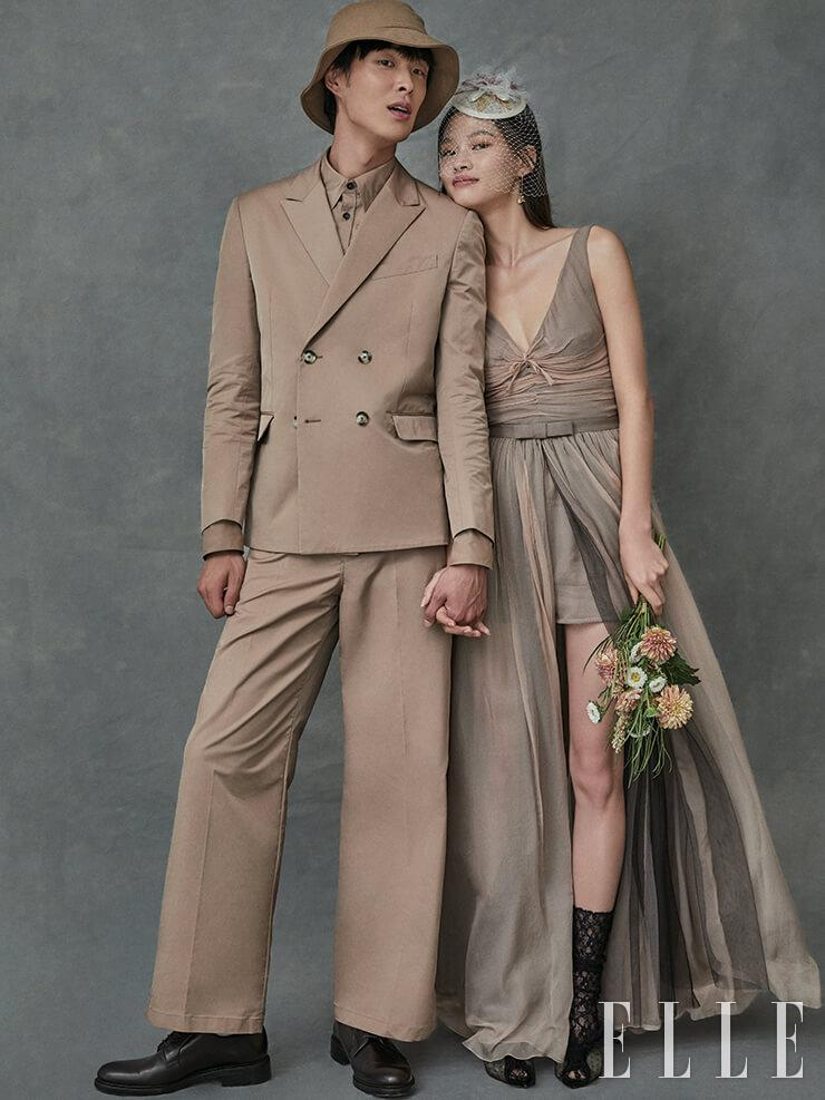 박진이 입은 더블 버튼 재킷과 셔츠, 팬츠는 가격 미정, 모두 Valentino Garavani-Undercover. 슈즈는 33만9천원, Unipair. 버킷 햇은 가격 미정, & Other Stories. 김아현이 입은 보디수트와 랩스커트는 가격 미정, 모두 Dior. 골드 이어링은 19만9천원, Didier Dubot. 프티 햇은 가격 미정, Angtt. 레이스 뮬은 1백6만원, Gianvito Rossi. 삭스는 스타일리스트 소장품.