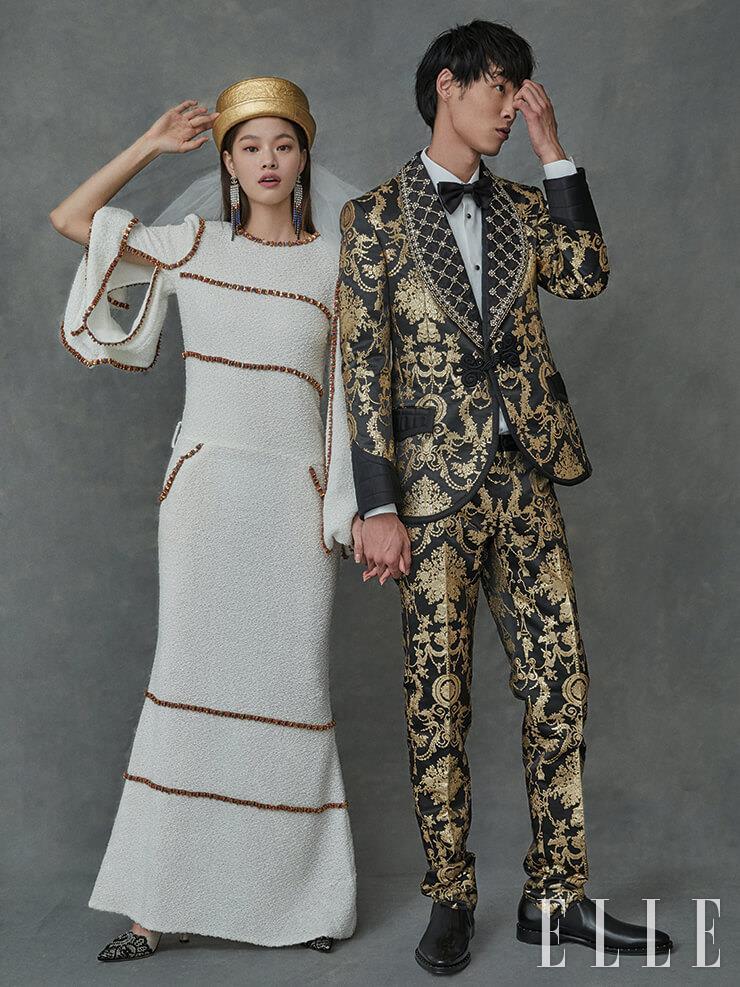 박진이 입은 화려한 자수와 스팽글 장식이 돋보이는 수트와 셔츠, 보타이, 슈즈는 가격 미정, Dolce & Gabbana. 김아현이 입은 트위드 소재의 드레스와 컬러 이어링, 골드 햇은 가격 미정, 모두 Chanel. 레이스 펌프스는 가격 미정, Manolo Blahnik. 쇼트 베일은 가격 미정, Maison Reve.