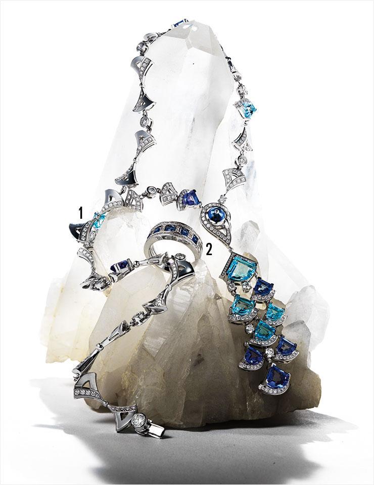 1 화이트골드에 토파즈와 탄자나이트를 세팅하고 다이아몬드로 화려하게 장식한 '디바스 드림' 네크리스는 8천2백만원대, Bvlgari. 2 블루 사파이어와 다이아몬드를 세팅한 화이트골드 링은 7백14만원, Damiani.