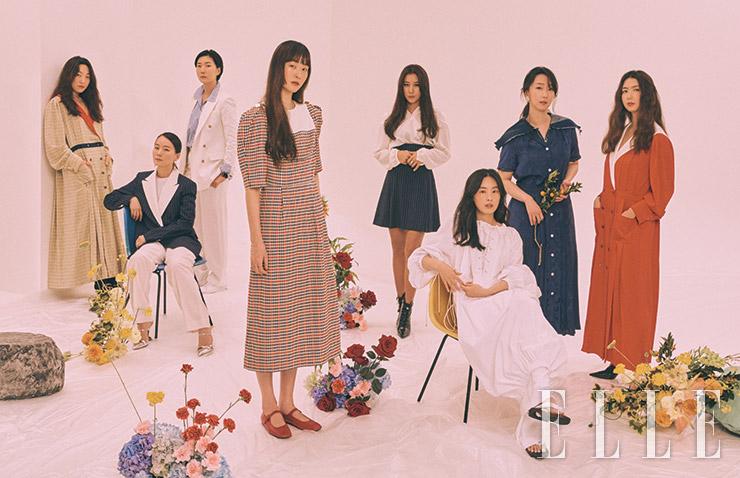 (왼쪽부터) 원조연이 입은 레드 라펠 장식의 셔츠 드레스, 전효진이 입은 화이트 수트와 스트라이프 셔츠, 이혜미가 입은 네이비 컬러 재킷과 화이트 팬츠, 장수임이 입은 체크 패턴의 퍼프 소매 원피스와 메리 제인 플랫 슈즈, 박지현이 입은 흰색 실크 셔츠와 네이비 미니스커트, 안정희가 입은 내추럴한 실루엣의 스트링 화이트 드레스, 남궁선이 입은 네이비 원피스와 안에 입은 네이비 플리츠 톱, 남궁현이 입은 레드 컬러 셔츠 드레스는 모두 EENK. 이혜미가 신은 메탈릭한 실버 슈즈는 가격 미정, Prada. 드롭 이어링은 Chanel. 박지현이 신은 부티 힐은 가격 미정, Louis Vuitton. 안정희가 엄지에 착용한 골드 링은 가격 미정, Givenchy. 남궁현이 신은 블랙 힐은 가격 미정, Givenchy.