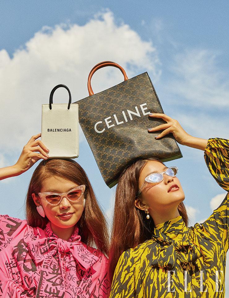 예슬이 입은 낙서 패턴의 베이비 돌 원피스는 3백53만원, 크리스털 장식의 하트 셰이프 이어링은 73만원, 레터링 프린트의 미니 백은 99만원, 모두 Balenciaga. 핑크 렌즈의 캐츠 아이 선글라스는 가격 미정, Dolce & Gabbana. 유진이 입은 애니멀 패턴의 원피스는 1백77만원, N°21. 로고 프린트의 토트백은 1백90만원, Celine. 글리터 장식의 캐츠 아이 선글라스는 40만원대, Miu Miu by Luxottica. 진주 장식 이어링은 8만8천원, S_ S.il.