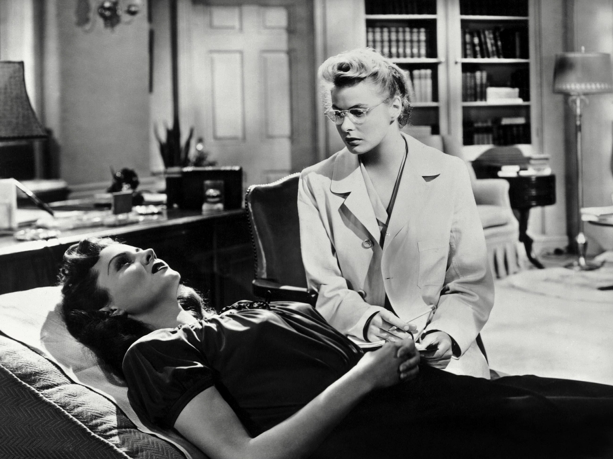 Rhonda Fleming & Ingrid Bergman Characters: Mary Carmichael & Dr. Constance Petersen Film: Spellbound (USA 1945) Director: Alfred Hitchcock 31 October 1945   Date: 31-Oct-1945