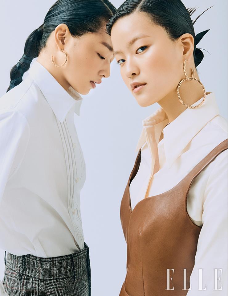 아라와 유진이 함께 착용한 18K 핑크골드 소재의 '클래쉬 드 까르띠에' 후프 이어링은 9백만원대, 유진이 낀 후프 이어링과 레이어드한 '클래쉬 드 까르띠에' 브레이슬렛은 1천만원대, 모두 Cartier. 아라가 입은 핀턱 디테일의 셔츠와 체크무늬 팬츠는 가격 미정, 모두 Ports 1961. 유진이 입은 셔츠는 70만5천원, 레더 뷔스티에는 2백14만5천원, 모두 Tod's.